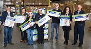 Sam Stranger, left, Staci Ignell, Susie Diaz, Diana Castillo, Jim Floros, Assemblywoman Lorena Gonzalez, Dennis DuBard deliver 8,000 diapers to the San Diego Food Bank. Photo courtesy of General Dynamics NASSCO