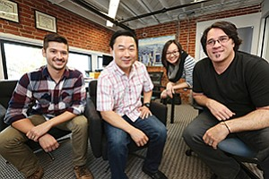 SparkFin employees from left, Phillip Moorman, CEO Jason Pang, Maricela Chan, and CTO Tom Walpole.