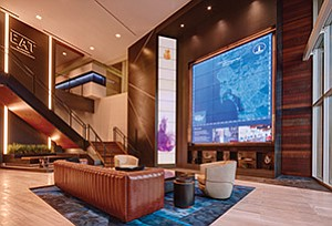 A digital media screen and abstract art are features in the lobby of The Alexandria at Torrey Pines. Photo courtesy of The Alexandria at Torrey Pines