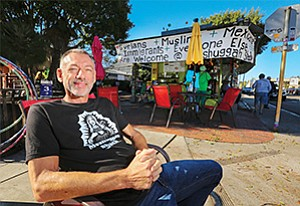 John Bertsch says he supports the minimum wage increase and is increasing prices at his two eclectic Meshuggah Shack locations and working more shifts himself to cover the added costs.