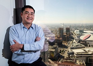 Towering Development: Thomas Feng with Oceanwide Holdings' $1 billion mixed-use construction project in the background.