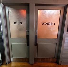 Switch: Men's and women's bathrooms at Santa Monica restaurant Art's Table.