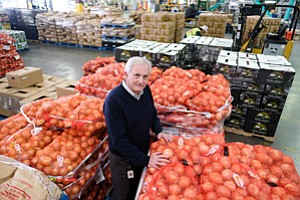 Pickup in Bag: Jim Leimkuhler at Progressive Produce's Commerce warehouse.