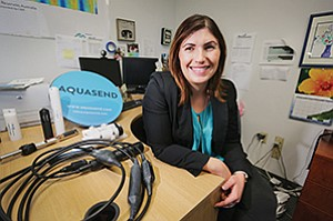 Kristin Elliott, who took over the family business, has adapted a technology developed by her father for use by aquaculture farmers.