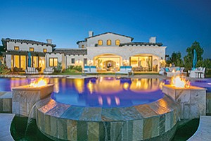 The view at dusk of the pool and home at 7967 Camino Sin Puente in the Cielo community of Rancho Santa Fe. Photos courtesy of PreviewFirst