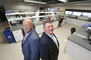 Mark Ortenzi, left, and Chris Orlando of ScaleMatrix have been called 'gutsy guys' for taking an unusual approach for a data center to develop new customers. They have opened a biotech accelerator with a wet lab and a coworking space.