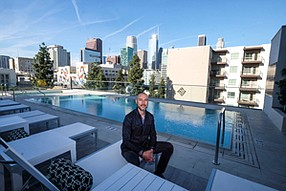 On Deck: Arden Hearing sits poolside at the Ten50 condo tower downtown.