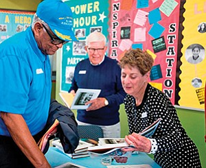 Boys & Girls Clubs of Greater San Diego alumni member, A.C. Mills, discusses the 75th anniversary book with the author, Marilyn Campbell, at the book release event. Photo courtesy of Gary Payne