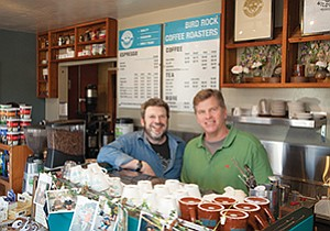 Jeff Taylor, left, co-founder and CEO of PT's Coffee Roasting Co., found the perfect blend with his recent acquisition of Bird Rock Coffee Roasters, owned by Chuck Patton.