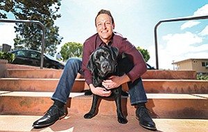 D.J. Todd of Pacific Beach co-founded Puptimize Inc., a startup that offers a dog-training app. Nessie, his 1½-year-old Labrador retriever, has helped him develop the content.