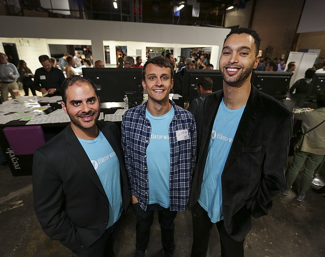 Left to right, Rayan Bouajram, Scott Herren and Harrison Schaen, executive directors of the nonprofit Startup San Diego, attend the group's March Mingle.