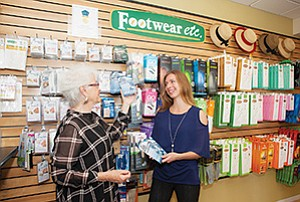 Laina Gossman, right, stumbled into the orthotic business working at a boutique while attending San Diego State University.