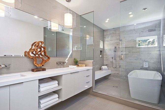 Shower space outfitted with a bathtub.