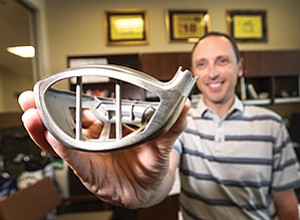 """Callaway Golf's Alan Hocknell shows the core of the new Great Big Bertha Epic driver. The club's """"Jailbreak Technology"""" consists of two reinforcing bars cast into the titanium club head, just behind the face."""
