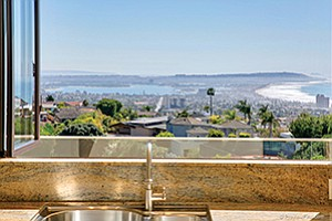 The view from the kitchen sink in a home at 5775 La Jolla Mesa Blvd. in La Jolla. Photo courtesy of Coldwell Banker Residential Brokerage