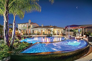 A view at dusk of the pool and extensive outdoor entertainment area at 14896 Whispering Ridge Road in the Stonebridge Estates community in San Diego. Photos courtesy of #SDVIPAgent