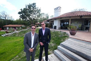 Focused In: Horacio LeDon, left, and Mark Rutstein at the 'Oak View Land' house.