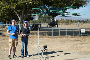 In Control: FlyCam UAV's Operations Manager Jeff Barnett and Chief Executive Jeri Donaldson test flying an eight-propeller Neo drone made by AceCore Technologies.