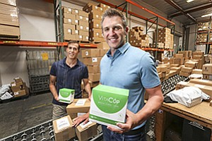 Brandon Fishman of VitaCup, center, and Michael Ishayik of Intelligent Blends