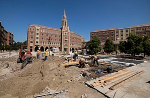 Big Move: Workers at USC Village project.