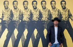 High-End Exhibition: Knowledge Bennett with one of his  artworks at a for-sale home in Bel Air.