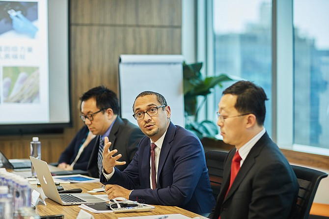Illumina's President and CEO, Francis de Souza, meets with Chinese officials to discuss health and technology - Photo courtesy of Illumina Inc.