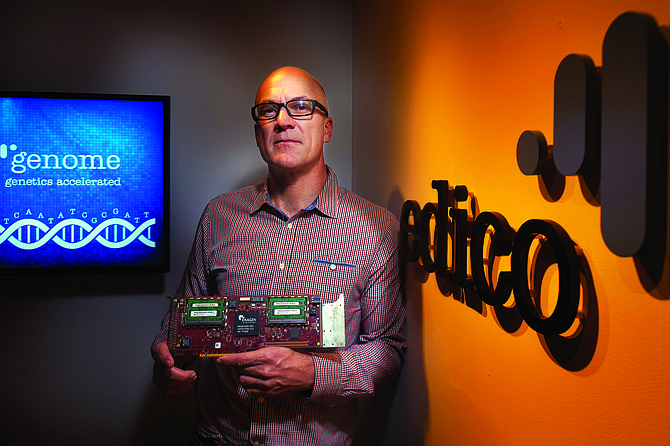 Edico Genome's CEO Pieter van Rooyen holds the Dragen processor -- Photo by Stephen Whalen