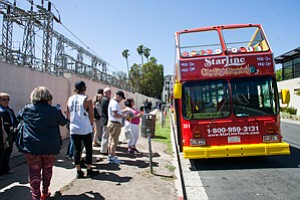 Making Inroads: Customers line up outside of a tour bus in Beverly Hills.