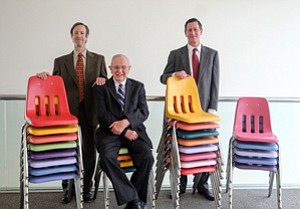 Stacking Up: Doug, left, and Robert Virtue, and Bob Dose with Virco's signature schoolroom chair.