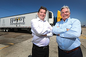 Kevin Leavy, left, and Jay Leavy expect to bring in $4 billion in sales since merging Harvest Food with another family run operation, Sherwood Distributors.
