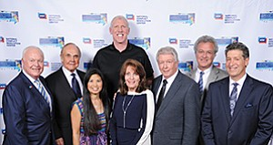 Tom Turner, left, Dick Enberg, Bill Walton, Lori Walton, Sandy Scott, Darrell Scott, Richard Cohen and Steven Dinkin at the 29th Annual Peacemaker Awards dinner and fundraiser for the National Conflict Resolution Center. Photo courtesy of National Conflict Resolution Center