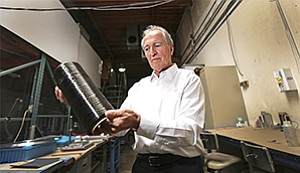 Where it all begins: Tim Knowles holds a spool of carbon fiber, which his company, Kulr Technology Corp., transforms into heat sinks and a new system to prevent thermal runaway in lithium-ion batteries. Knowles has done extensive work on NASA spacecraft.
