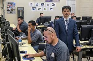 Building Skills: Miodrag Micic with engineering design students at Cerritos College.