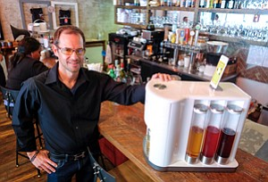 Cheers: Christopher Hameetman, Somabar co-founder and president, with one of the company's drink-making machines at customer House of Meatballs in Westwood.