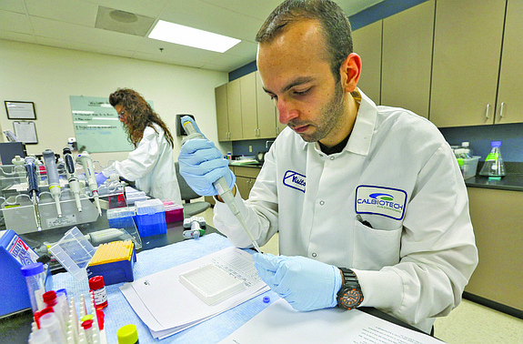 Joseph Alosachine in the lab at Calbiotech. The company makes immunoassays and related items. Calbiotech ships to 70 countries with half its revenue coming from exports - Jamie Scott Lytle.