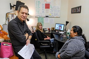 In Spotlight: John Paizis opposite a client at Performing Arts Studio West, an Inglewood organization that trains disabled actors and helps them find roles.