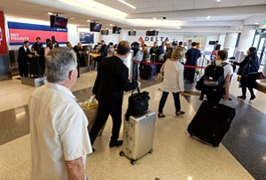 Flying High: Travelers check in at an LAX terminal of Delta Air Lines, which was the No. 3 carrier last year at the L.A. area's four airports with 13.7 million passengers.