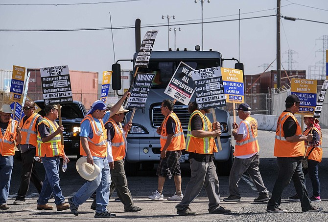 Warehouse workers strike on Port of Los Angeles land in Wilmington.