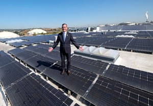 Heating Up: Los Angeles Mayor Eric Garcetti tours San Pedro's Westmont Solar Energy Project, with more than 50,000 panels across 50 acres of rooftop space.