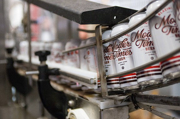 Beer is packaged on canning lines at the main Point Loma facility of Modern Times Beer. -- Photo courtesy of Modern Times Beer