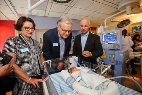 Dr. Philippe Friedlich (right), CHLA's chief of Neonatology, with Teresa and Byron Pollitt, discussing care and treatment of vulnerable infants. Photo courtesy of Children's Hospital Los Angeles