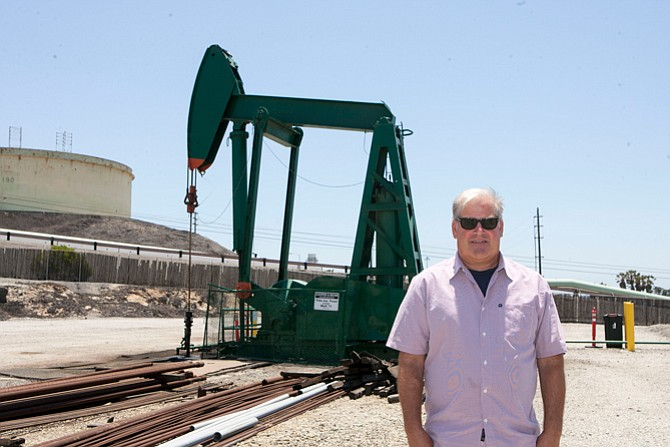 Up or Down?: Jeff Cooper at one of his firm's oil wells in El Segundo in 2015.