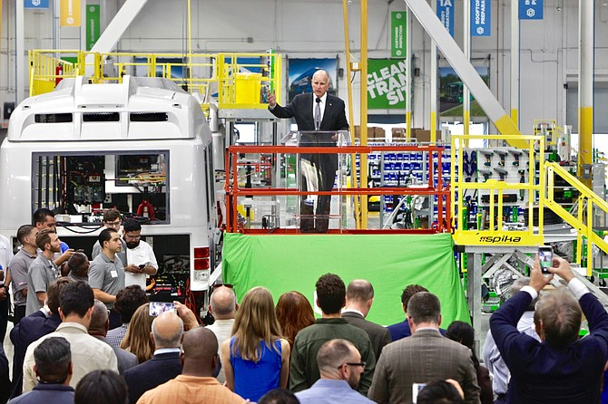 Governor Jerry Brown at electric bus manufacturer Proterra Inc.'s new manufacturing facility in the City of Industry on Wednesday.
