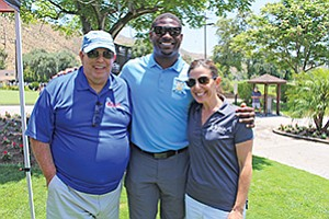 George Hadjis of Oggi's, left, LaDainian Tomlinson and Estella Ferrera of Oggi's at the 2nd Annual Oggi's LaDainian Tomlinson Celebrity Golf Tournament. Photo courtesy of Oggi's Sports |Brewhouse| Pizza