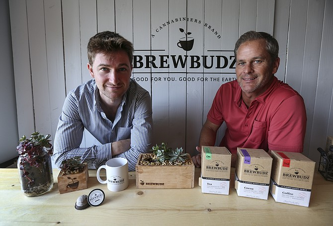 Kevin Love, left and Ren Bowden with Cannabiniers display some of the BrewBudz products. The method the company uses is said to improve the taste of edibles. Photo by Jamie Scott Lytle.