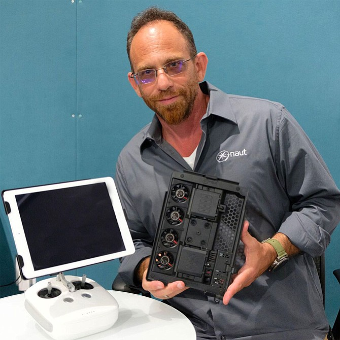 Fans of iPad: X-naut's Darren Saravis with company's device-cooling bracket.