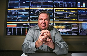 Marc Clark sits in the Pulse Real-time Operation Center at Teradata Corp.'s Rancho Bernardo office. Clark is Teradata's director for cloud strategy and deployment, though he is informally known as the cloud evangelist.