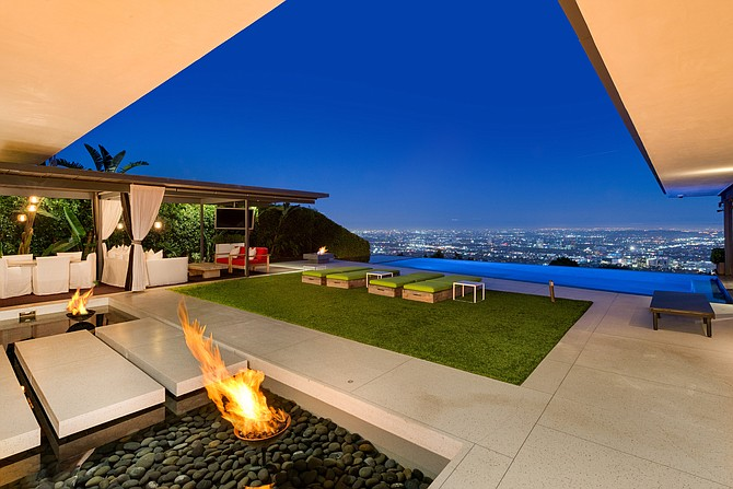 Partners Trust, which is merging with Pacific Union International, brokers prominent residential real estate deals such as this Hollywood Hills home listed by actor Matthew Perry.