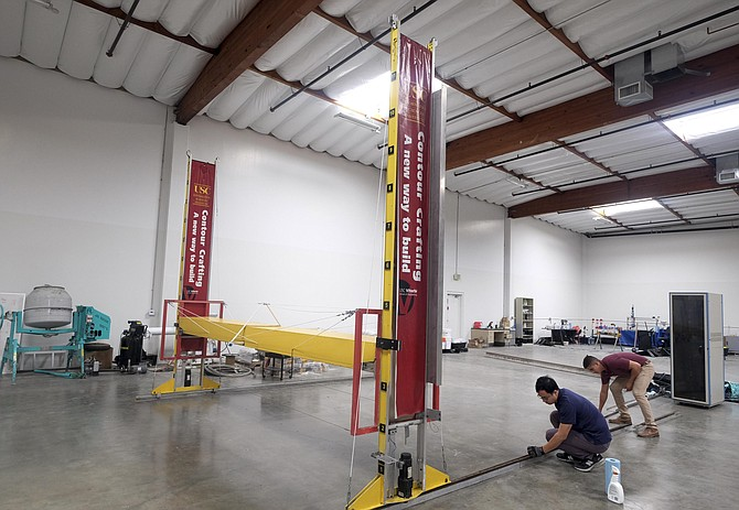 Special Delivery: Crew with a 3-D printer at Contour Crafting Corp. in El Segundo.