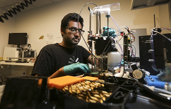 Fabric8Labs' Shiv Shailendar works in the company's lab at EvoNexus' new home at University Town Center. Photo by Jamie Scott Lytle.